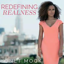 Janet Mock wearing a salmon dress