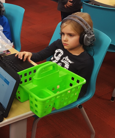 students listening to audio books on tales2go