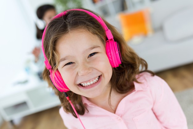 girl with pink headphones.jpg