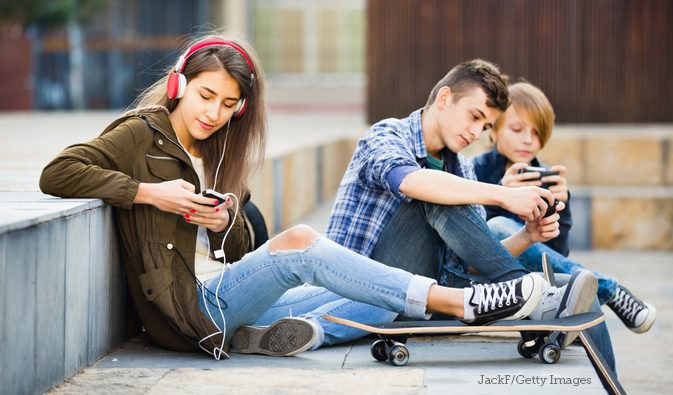 Teens listening to music outdoors