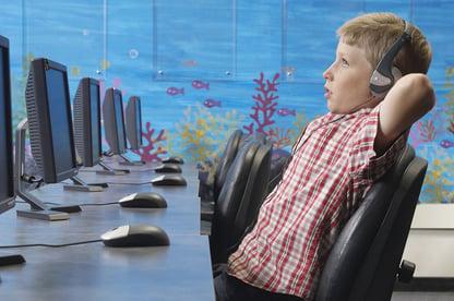 boy listening at computer.jpg