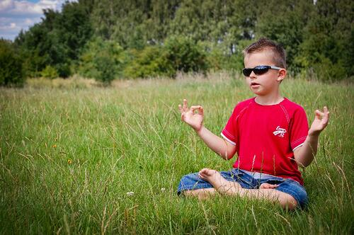 calm relaxed meditating boy
