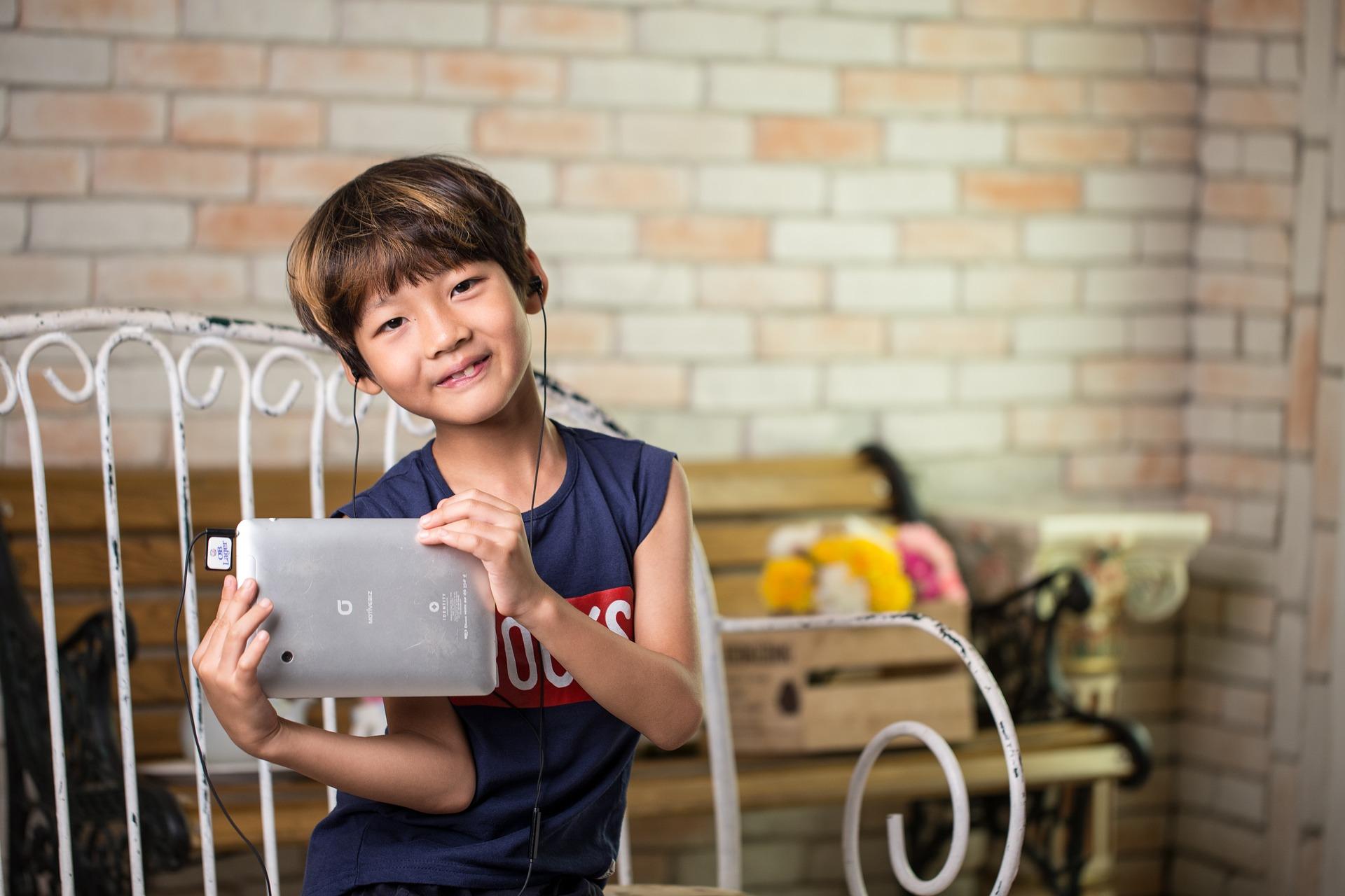 boy listening to ipad.jpg